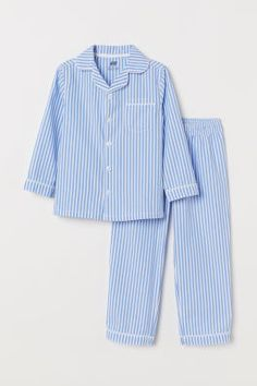 Pyjamas with a shirt and bottoms in an airy cotton weave. Shirt with a collar, buttons down the front, long sleeves and a small chest pocket. Night Suit For Girl, Mode Streetwear, Cotton Pyjamas, Pajamas Women, Fashion Company, Neue Trends, World Of Fashion, Blue Stripes, Pajama Set