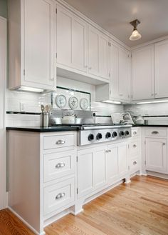 This gorgeous house epitomizes the classic Craftsman style. Restored built-in cabinets offer storage galore, while period-appropriate lighting and a neutral palette let the house's architectural details shine.