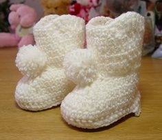Handmade Crochet Girl Baby Booties Boots White with Pom Poms Accent by Dis Lil Treasures, $14.95. Makes a Great Baby Shower Gift! Some Say They Were The Hit of The Party!