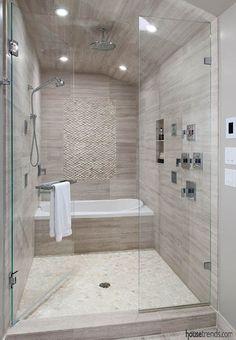 Bathroom design brings two spaces together..bathtub in the shower??!! Wonderful!