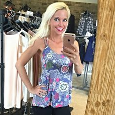 Beautiful lavender and pink tank w/top back detail Beautiful lavender floral tank with stunning colors!! And cross back! Tops Tank Tops