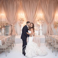 Floor to ceiling wedding backdrops, Champagne draping & Floral Urns