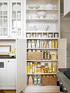 15 Beautifully Organized Kitchen Cabinets (And Tips We Learned From Each) ~ Use large baskets to corral small packaged goods bags to keep the cabinet from feeling too cluttered.