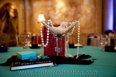 Breakfast at Tiffany Table decor with pearls, martini glass, cigarette holder....
