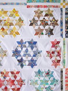Gorgeous scrappy stars at Seven-Sisters at http://qisforquilter.com/2014/04/seven-sisters-quilt-top/.