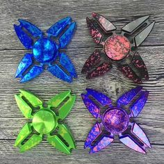 Description:Four Corners Crab Colorful Rotating Fidget Hand Spinner Size:Diameter 65mm  Material:Aluminum alloy Weight:50g Spinning lasting...