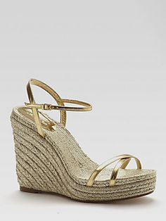 Please oh please let me wake up and see these in my closet tomorrow morning. (Gucci Lia Metallic Leather Espadrille Wedges at Saks *hint hint* ;-)