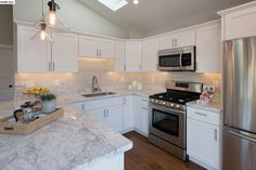 Image result for carrera marble in kitchen with pendant lights