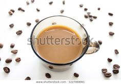 Full coffee cup with coffee beans on white background. Coffee still life. #coffee #coffeecup