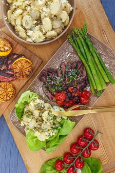 Rachael Ray's Sliced Hanger Steak with Roasted Tomatoes, Olives, Potato Salad with Dijon and Egg, Asparagus with Lemon