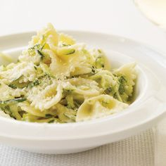The shredded zucchini cooks along with the farfalle in this tangy pasta from Johanne Killeen and George Germon of Al Forno restaurant in Providence, Rhode Island. More Fast Pasta Recipes Easy Pasta Recipes, Wine Recipes, Easy Meals, Cooking Recipes, Fast Recipes, Delicious Recipes, Cooking Bacon, Cooking Games, Mexican Recipes