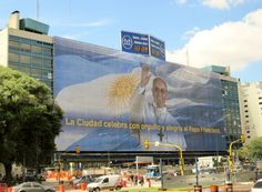 Local pride on display as a Buenos Aires downtown building honors Pope Francis, April 2013.