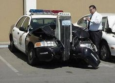 25 Photos Of The Most Stupid Car Accidents ~ WHICH CAME FIRST, THE COP CAR OR THE TELEPHONE STAND?