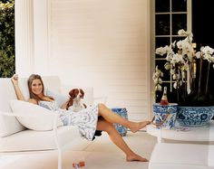 "Aerin Lauder (in Carolina Herrera) with Biscuit. Photographed by Eric Boman. ""From the Archives: Aerin Lauder's Wainscott Home, "" Vogue (July 2, 2011)"