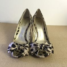 Guess by Marciano Peep Tow Bow Leopard Wedges These adorable and easy to wear Guess by Marciano peep toe bow wedges will make heads turn! They are in great condition with just a few scratches on the inside of the shoe. Guess by Marciano Shoes Wedges