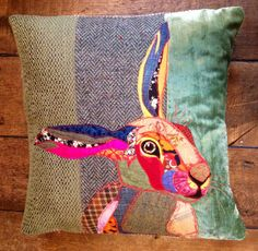 Hand made appliqued pillow, of a hare on a velvet, tweed and green background. A…