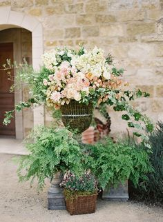So do you suppose the big one is a variety of potted plants or a floral design done with cut stems?