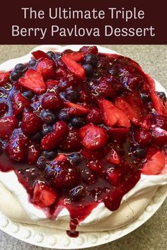 The Ultimate Triple Berry Pavlova Dessert (Meringue Cake) features light as a cloud meringue topped with sweetened whipped cream and juicy ripe berries. Easy Holiday Recipes, Easter Recipes, Pavlova, Easy No Bake Desserts, Dessert Recipes, Meringue Cake, Meringue Food, Desserts Ostern, Dessert For Two