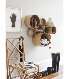 This is growing on me. I like the circle shelving idea for winter when all those mittens, scarves, and hats get lost in the bins