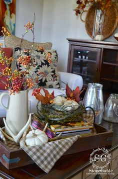 I'd like to use my new plaid tea towel on our wooden tray with pumpkins and bittersweet in an old pitcher like this for Narthex.