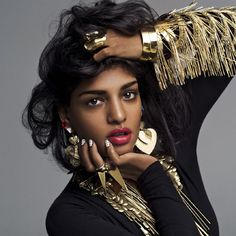 M.I.A. Portrait by Inez & Vinoodh It's a great photo.. I love the jewelry too.