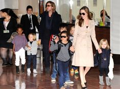 Angelina Jolie, Brad Pitt & Pax from Brad & Angelina Family Album | E! Online