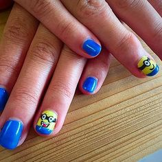 Check out these super fun minion nails by Genia!
