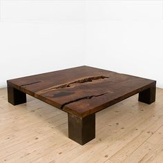 """The Kong Coffee table is created from a one-of-a-kind hardwood slab set on a frame of four 7"""" x 7"""" steel boxes with a blackened or powder coated finish.   Our large wood slabs are locally milled and dried and come from sustainably harvested trees"""