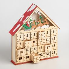 Give your Christmas countdown a warm, woodsy feel with our intricately detailed, house-shaped advent calendar. Its laser-cut wood drawers let you hide 24 days' worth of small trinkets or treats, while battery-operated LED lights illuminate the festive scene above.
