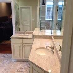 Vanity mirrors to the ceiling, granite counter tops and tile floors.