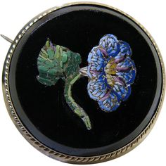 Antique Victorian 14K yellow gold mounted micro mosaic pin. Elegant in its austerity, the beautiful little flower is very three-dimensional, colorful