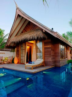 Love the little palm thatch roof over the door - must have over pool sitting area