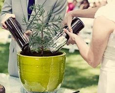 I love this take on the Unity Candle/Sand Pouring!    Using soil from the parents' homes and planting a tree for their new home with it!
