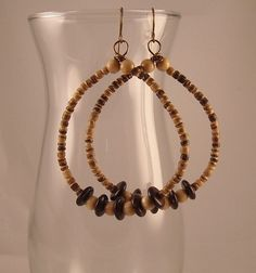 These earrings are very lightweight. They are made with beads made from coconut shells and brass non-tarnish artistic wire. Hoops measures wide and dangle long. Shell Earrings, Wire Earrings, Artistic Wire, Seashell Jewelry, Beaded Curtains, Coconut Shell, How To Make Beads, Gold Beads, Lampwork Beads