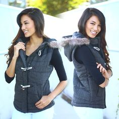AMAZING!! Our Black Padded Vest With Fur Hood is perfect to pair with any top! - it's simply wonderful for everyday wear. This look is super easy to wear and cozy which makes it great to wear during all seasons. The fur hood is just the most amazing detail! Definitely a MUST HAVE piece for your 2015 wardrobe! See other lovely vests at our online boutique!