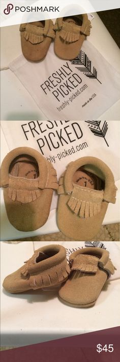 Freshly Picked Suede Baby Moccasins Freshly Picked infant moccasins. Fringe detail, size 1 in color weathered brown. Worn once, small water mark on bottom of toe of one shoe as shown in picture. Comes with dust bag. Adorable on little baby feet - neutral goes with every outfit!                                                  🐶All items come from a pet friendly home!🐶 Freshly Picked Shoes Moccasins