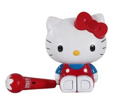 Now you can be a pop star with the Hello Kitty Sing-a-Long Karaoke. This portable system is powered by 3 AAA batteries; it picks up radio stations, or you can p Hello Kitty Games, Hello Kitty Bow, Kids Electronics, Hobby Trains, Metallic Yarn, Thing 1, Cat Toys, Karaoke, Kids Christmas