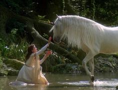 Legend (1985) by Ridley Scott, with Mia Sara as Lily and costume design by Charles Knode - white Lily and unicorn
