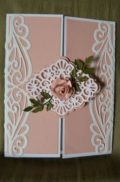 Another beautiful tri-fold card, but instead of using a striplet die, Joan used the Sue Wilson Ursa Gemini die on the panels and the