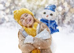 girl playing with a snowman royalty-free stock photo