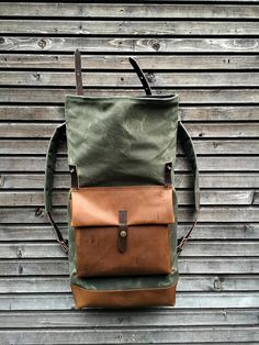 Waxed canvas backpack with roll up top and oiled leather