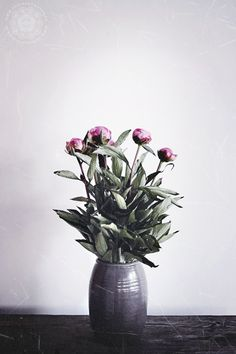 Peonies on the table. Vase from Tine K