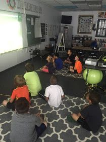 Flexible Seating in a First Grade Classroom-  Which lead me to buying another rug from Target, and I came up with this set-up. My rule for students was that your body must be on one of the carpets. This way I had an aisle as a walkway for me to go back and forth from the table to my board.