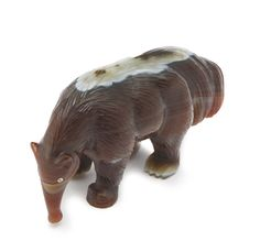A RUSSIAN CARVED HARDSTONE ANTEATER, ST. PETERSBURG, CIRCA 1900 the giant anteater (myrmecophaga tridactyla) realistically carved of reddish brown striated agate, depicted standing on all four legs, with diamond-set eyes, possibly Fabergé