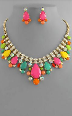 A bead and rhinestone bib necklace in neon shades on a gold chain with matching earrings. Neon Jewelry, Jewelry Accessories, Fashion Accessories, Necklace Set, Jewelry Box, Candy Necklaces, Colorful Candy, Vogue, Necklaces