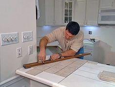 DIY remodeling expert Fuad Reveiz shows how to lay ceramic tiles over a laminate countertop and how to install a tile backsplash to match the new countertop. Outdoor Kitchen Countertops, Formica Countertops, Granite Tile, Bathroom Countertops, Concrete Countertops, Marble Countertops, Backsplash, Kitchen Counters, Kitchen Tile