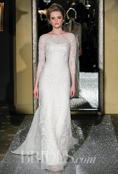 Brides.com: . Lace A-line gown with an illusion neckline and sleeves, Oleg Cassini