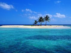 Sandy Island Off Lighthouse Reef Belize. I'd pack some food and make a day out of sitting here with a book (or an e-reader) in hand.