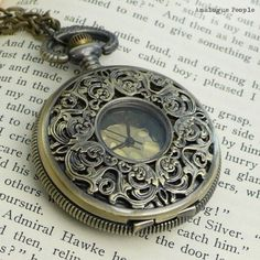 Antique Bronze Pocket Watch Necklace: http://www.etsy.com/listing/48712031/gorgeous-antique-bronze-pocket-watch?ref=sr_gallery_10_search_query=watch+necklace_search_type=all_page=5[]=tags[]=title