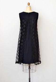 Image from http://www.adoredvintage.com/images/dresses/vintage1960sblacklaceoverlaydress_02.jpg.
